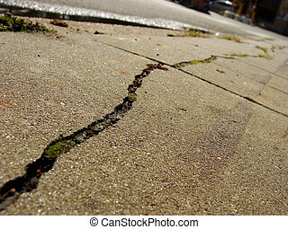 side-walk low angle view with long crack in pavement tiles