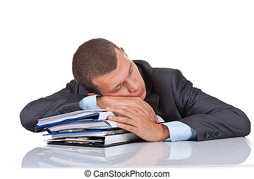 businessman sleep resting on stack of paperwork