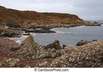 great colored rocky coast in Scotland - clouded coastal...