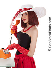 Fashion girl in retro style with vintage phone
