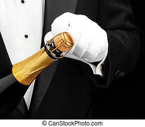 Waiter opening bottle of champagne - Closeup of a waiter...
