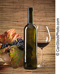 red wine bottle, glass, grapes, wicker background - bottle...