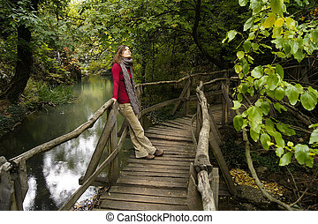 A walk in the park - Beautiful young woman contemplating on...