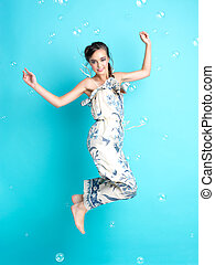 happy woman with balloons on blue background - beautiful,...
