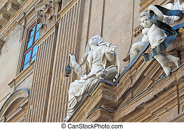 Statues on the front of the façade of a church