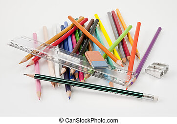 Very confused basic school supplies on a white background