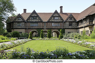 Schloss Cecilienhof, a castle in Potsdam Germany with park...