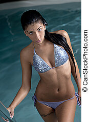 pretty young lady relaxing in the swimming pool - Closeup of...