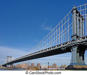 Manhattan Bridge in New York - dynamic city view of New York...
