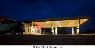 service station - illuminated service station near highway...