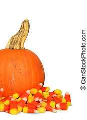 pumpkin in candy corn - Pumpkin in pile of candy corn...