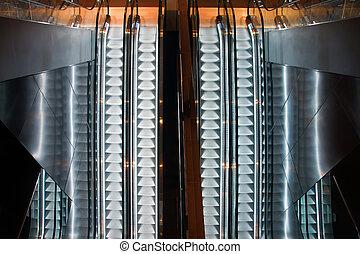 Escalators - Parallel escalators and reflections seen from...