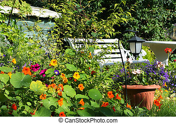Beautiful Summer garden with white bench