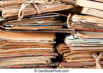 Old files - A stack of old files yellowing in an archive