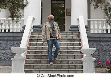 Middle-aged man down stairs