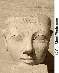 ancient face of Hatschepsut - historic stone sculpture in...