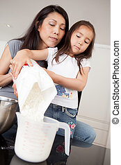 Mother and Daughter Measuring Ingredient - Mother and...
