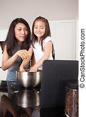 Baking Cookies Recipe on Digital Tablet