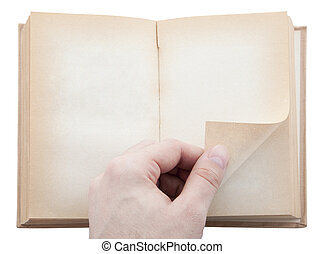 Hand turning old blank book page Clipping path included