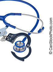 cuffs and stethoscope - handcuffs and a stethoscope lying on...