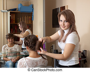 hair stylist working with   girl hair