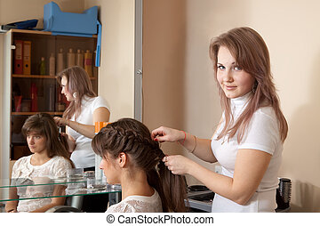 hair stylist working with girl
