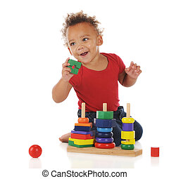 Im Gonna Do It - An adorable toddler boy happily assembing a...