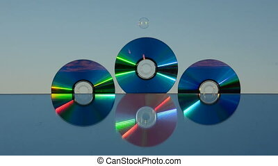 dvd discs and soap bubbles - dvd discs on mirror and soap...