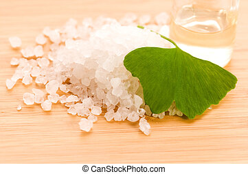 fresh leaves ginko biloba essential oil and sea salt -...