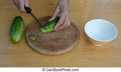 grandmother hands cut up cucumber