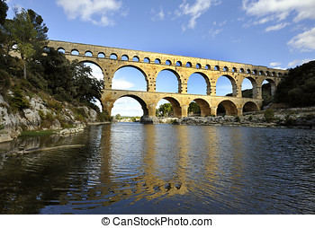 Roman aquaduct Pont du Gard, France at sunset