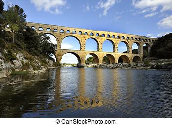 Roman aquaduct Pont du Gard, France at sunset