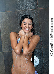 sexy young woman enjoying bath under water shower - Portrait...