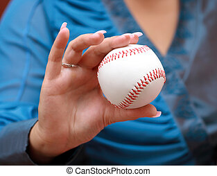baseball in woman hand