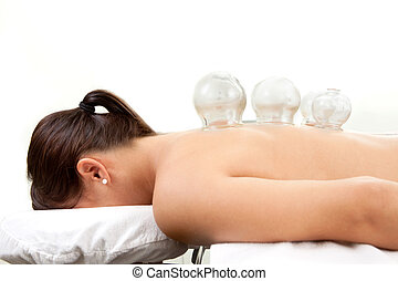 Cupping Treatment Detail - Detail of several cups placed on...