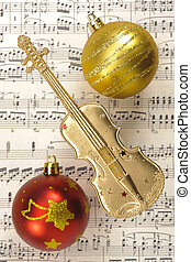 Christmas decoration with music sheet and violin