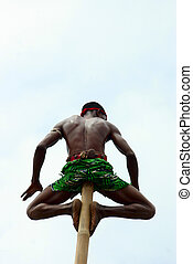African culture - close-up of a man sitting on a bamboo...