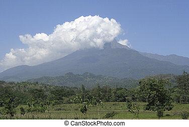 Mount Meru in Tanzania (Africa) covered in big white clouds