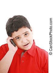Young boy talking to cell phone, isolated on white...