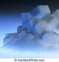 blue illuminated lump sugar pile - Studio photography of a...