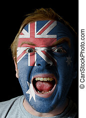 Face of crazy angry man painted in colors of australia flag...