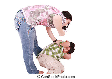Woman hitting a son who cringes, isolated on white...