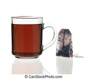 teacup and tea bag - glass teacup filled with tea and tea...