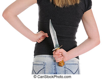 Young woman holding knife behind her. Isolated on white...