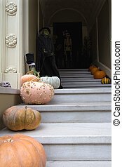 Halloween Decoration in Front of House with Witch