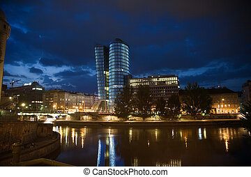 glass front of office tower by night