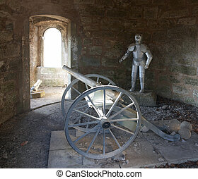 knight´s armor and cannon - knights armor and cannon in a...
