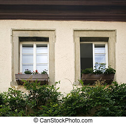 house facade detail with two old windows - architectural...