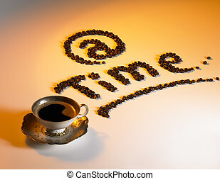 at coffee time - symbolic picture showing a coffee cup and...