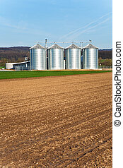 silo in beautiful landscape in sun - silo and acre in...